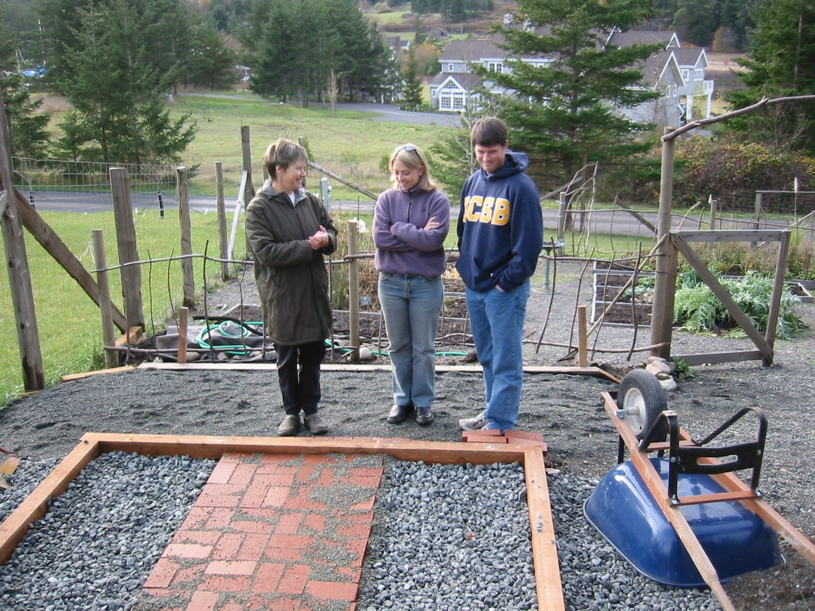 Yvonne explains greenhouse plan to Kristin and Eric
