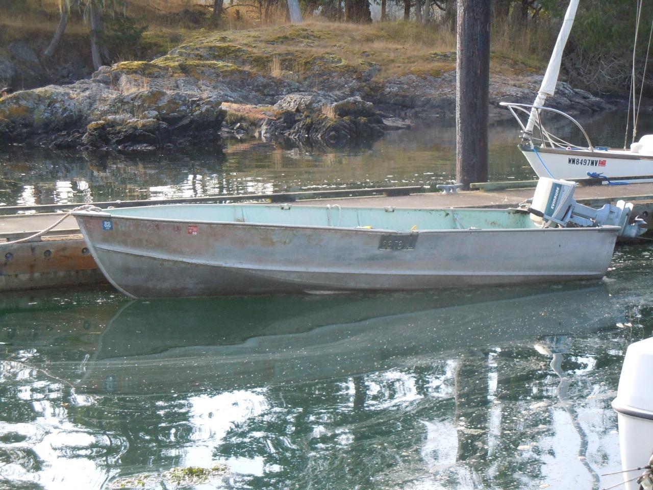 The Picnic boat: scavenged, damaged aluminum rowboat