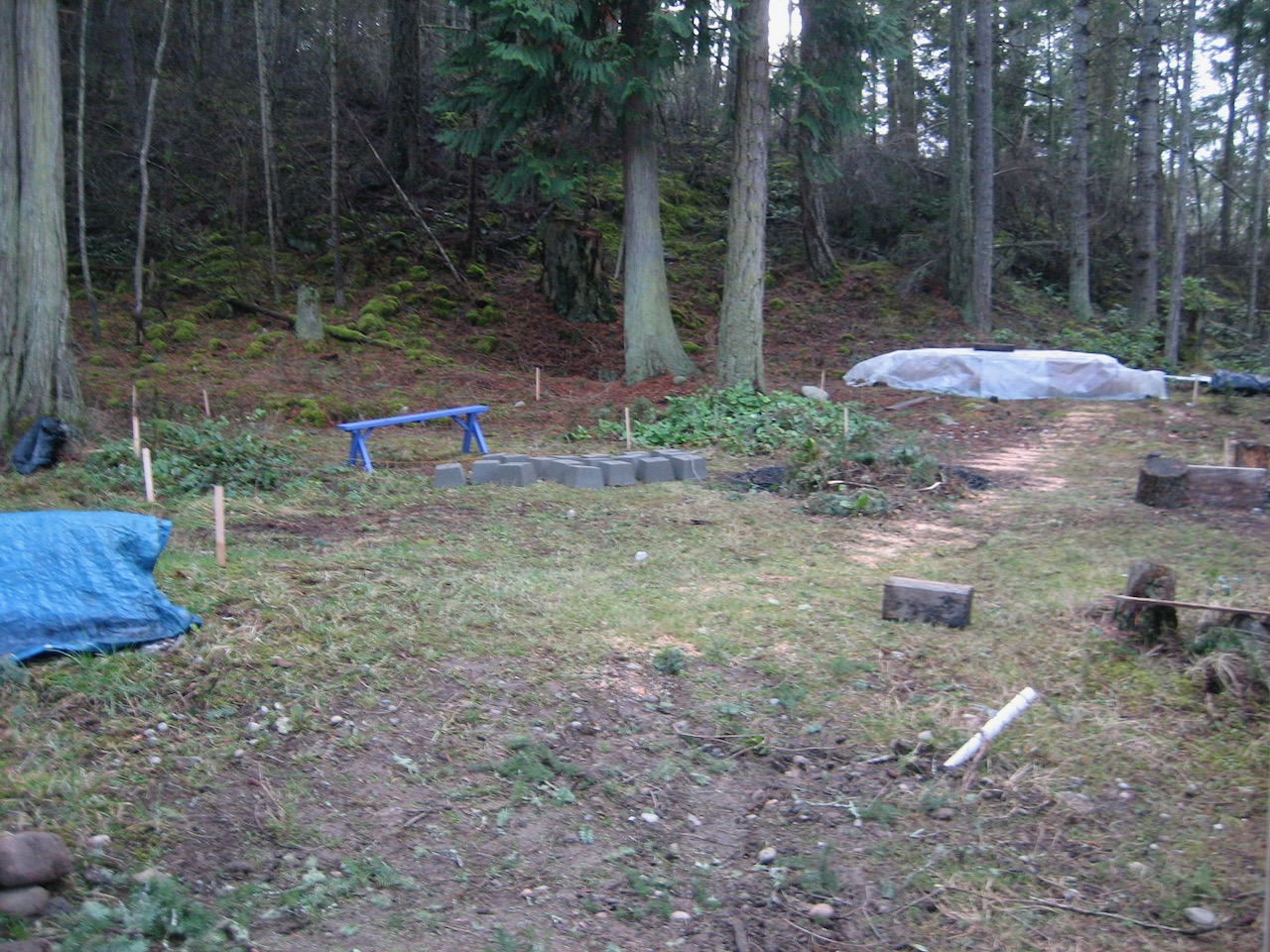 Corner stakes for two sheds under trees