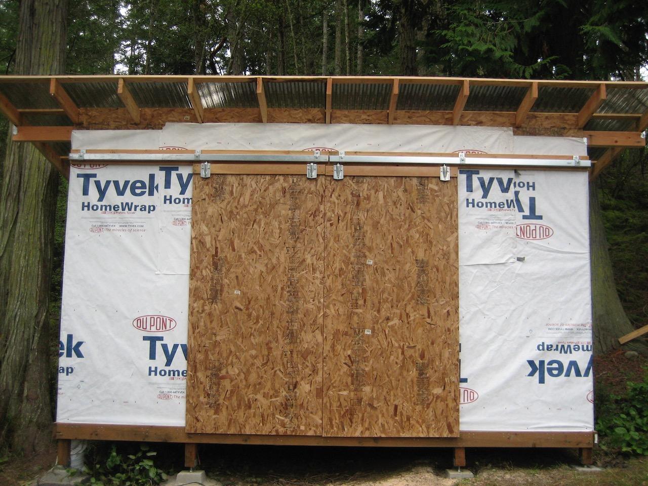 Two 4x8 strand board sliding doors
