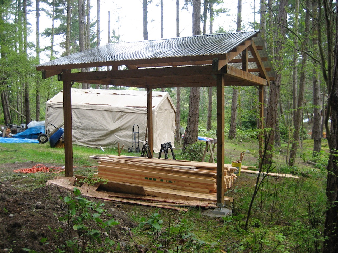 Raid shelter stores building materials during shed and patio building projects