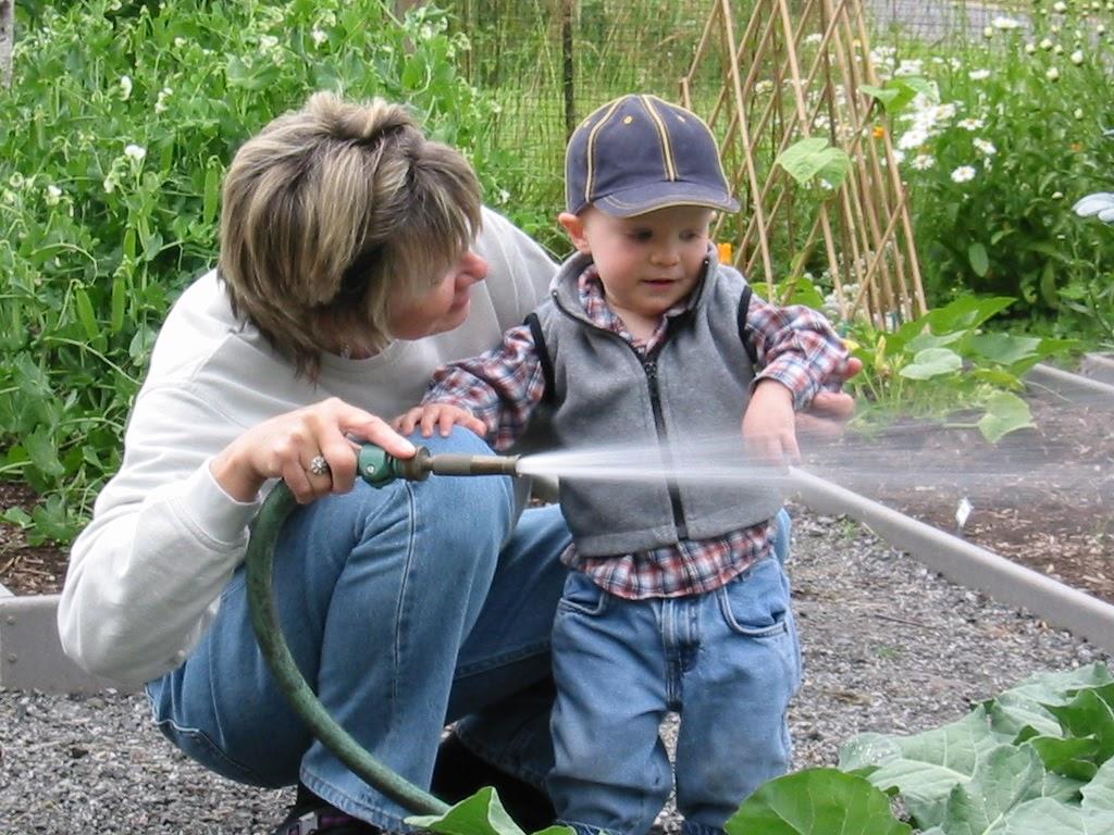 Morgan helps grandma water garden summer 2002